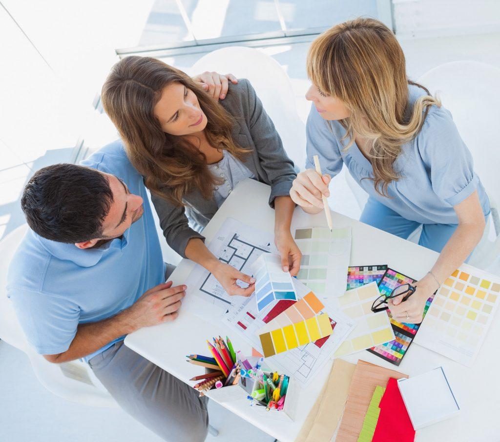 Kitchen designer with clients